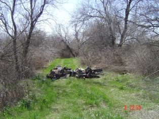 Illegal dumping of used car part North of Pablo